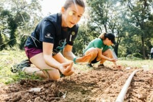 Atlanta volunteers planting seeds at an urban farm