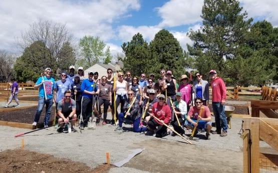 Group shot of Denver volunteers after working with Denver Urban Gardens