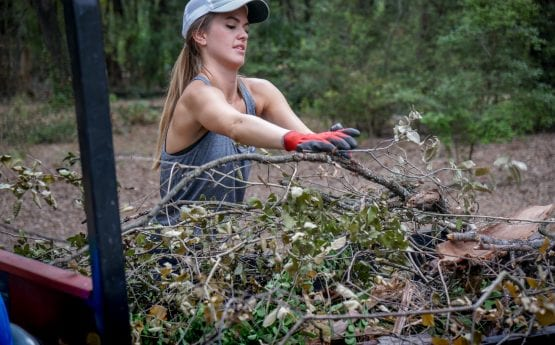 Girl in Austin volunteering to clean up the Zilker Botanical Gardens