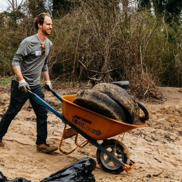 Atlanta volunteer hauling trash from river using tools from the Atlanta ToolBank