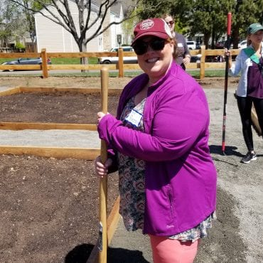 Denver volunteer standing in a garden
