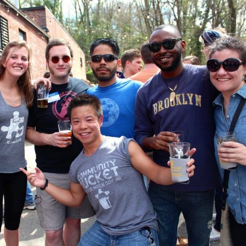 Group of volunteers spending time outside at a brewery in Atlanta
